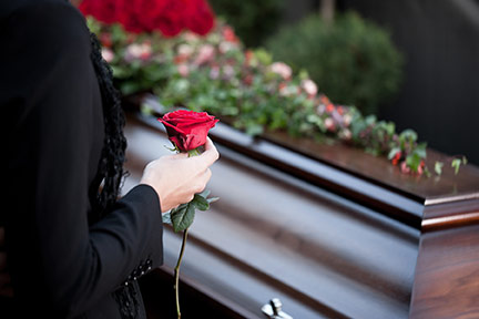 Funeral-with-coffin-rose-hand